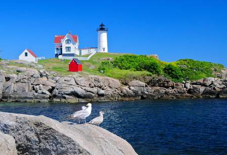 The Nubble lighthouse in York, Maine by Richard Cavalleri